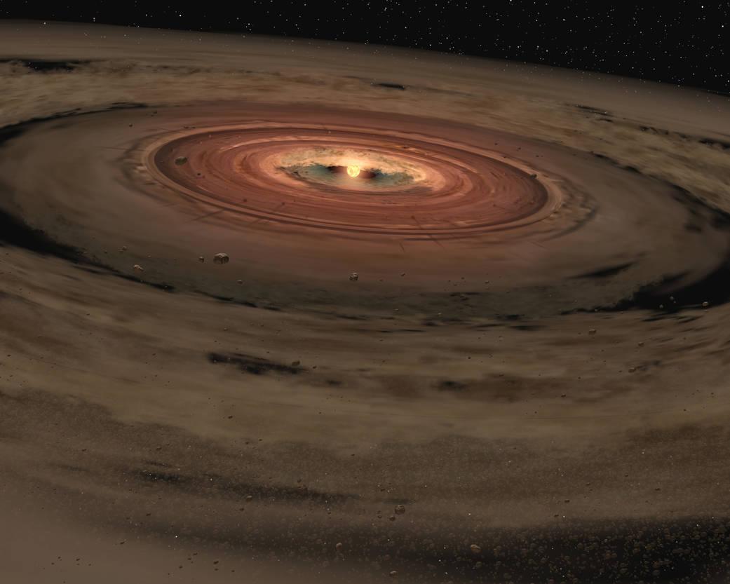 Vue d'artiste de la formation du Système solaire. Au centre, une boule brillante est la protoétoile qui correspond à notre bébé Soleil et le disque de gaz et de matière qui l'entoure est un disque d'accrétion dans lequel vont se former les planètes du Système solaire.