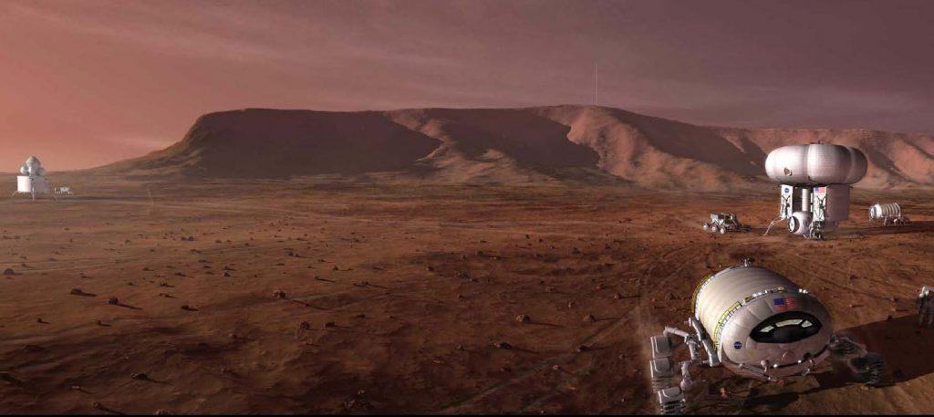 Vue d'artiste du projet Mars Design Reference 5.0. On voit sur le sol de Mars deux modules fixes et quatre véhicules mobiles.