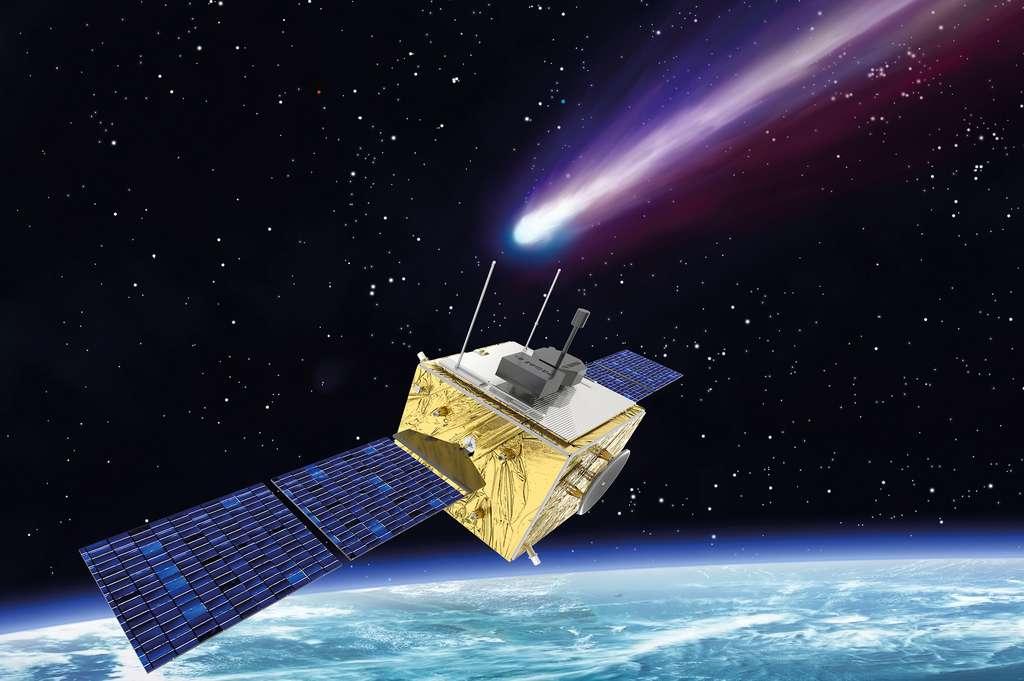 Vue d'artiste de Comet Interceptor : on voit une sonde assez classique, corps doré carré avec panneaux solaires bleu foncé, devant une comète à la queue violette. En fond en bas de l'image, la courbure de la Terre, et en fond sur le reste de l'image jusqu'en haut un ciel noir étoilé.