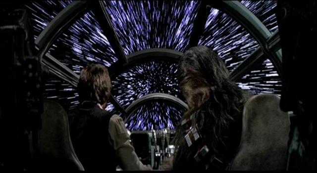 Photo de Han Solo et Chewbacca de Star Wars de dos dans un vaisseau allant en vitesse lumière.