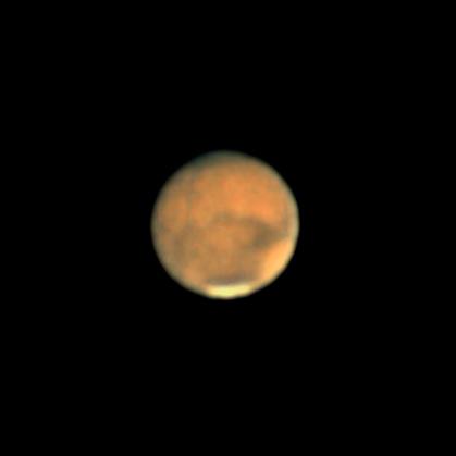 Photo prise lors de l'opposition de Mars en août 2020. On voit des détails de surface et en particulier la calotte polaire sud.